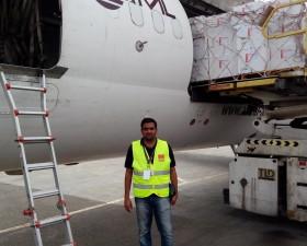 Vipin Sagar next to the UNICEF flight loading vaccines to Yemen