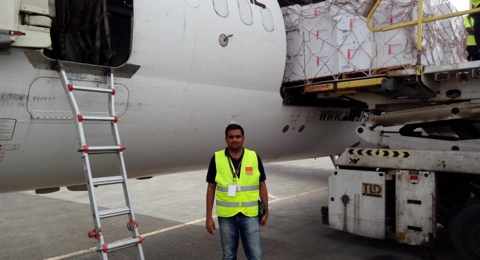 Vipin Sagar next to the UNICEF flight loading vaccines to Yemen