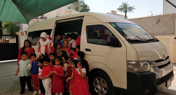 RIA students with their new bus